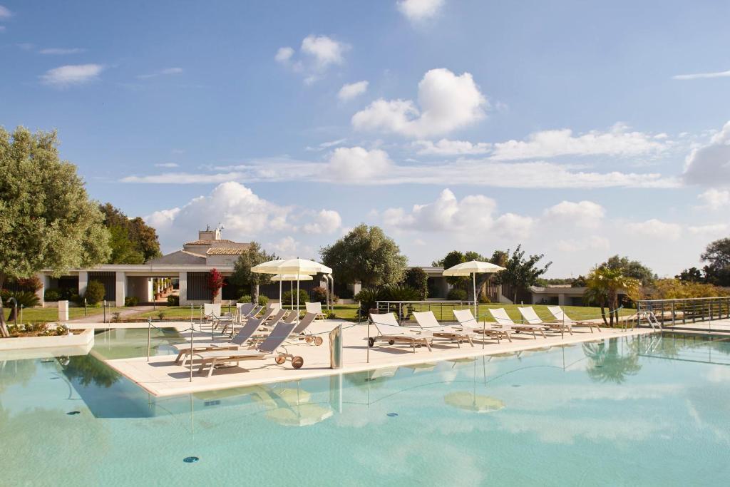 The swimming pool at or near I Monasteri Golf & SPA Resort