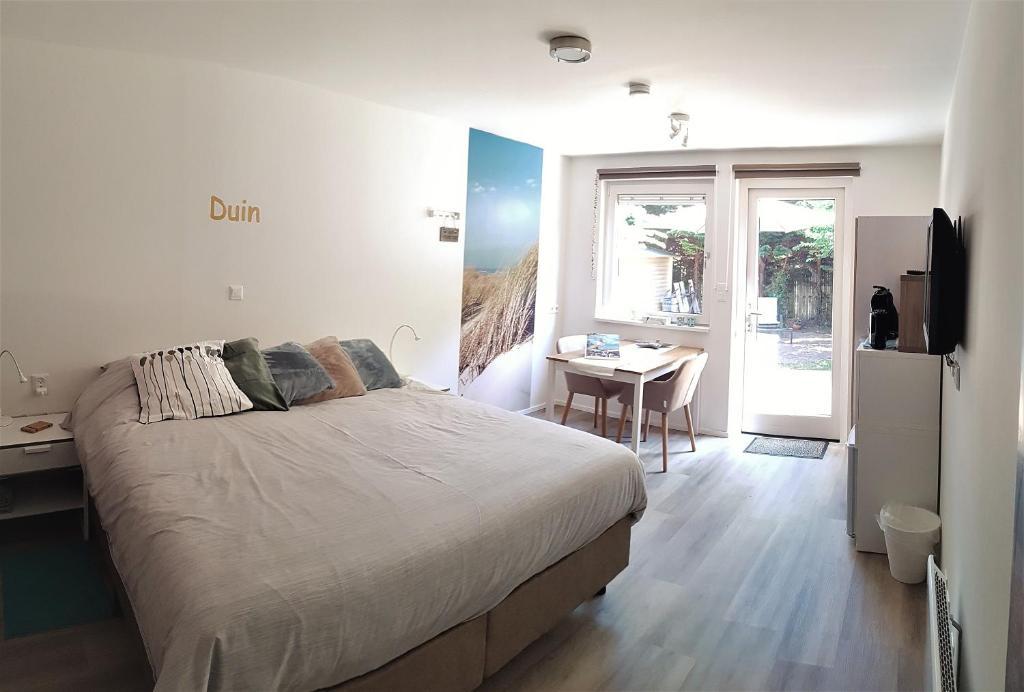 Un ou plusieurs lits dans un hébergement de l'établissement Duin en Zee Texel