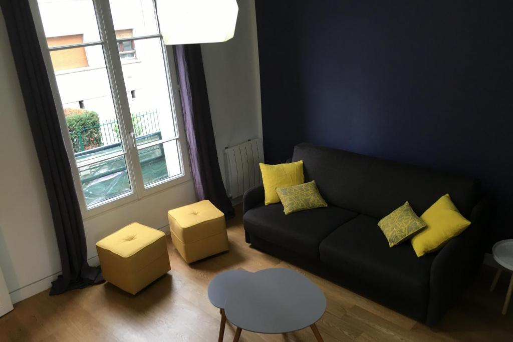 A seating area at Luckey Homes - Rue de l'ancienne Mairie