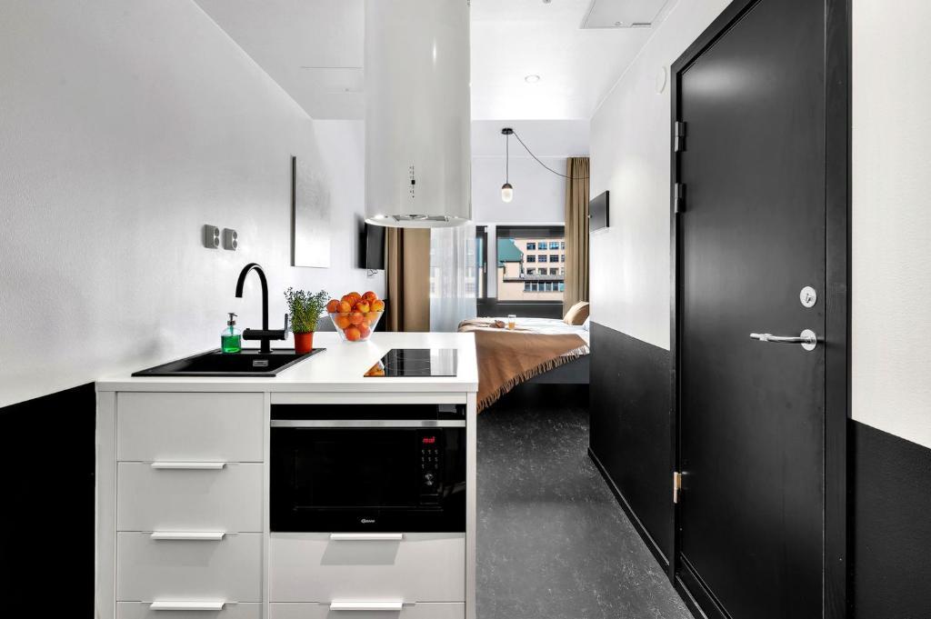 A kitchen or kitchenette at Forenom Aparthotel Oslo