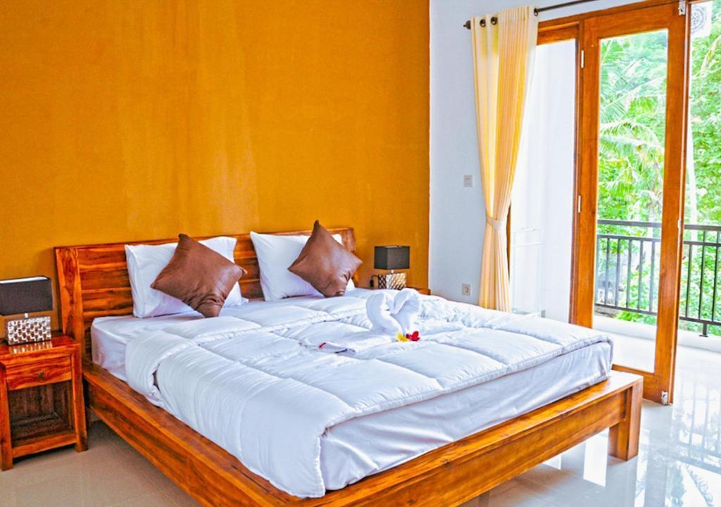 Letto o letti in una camera di Kailash Homestay