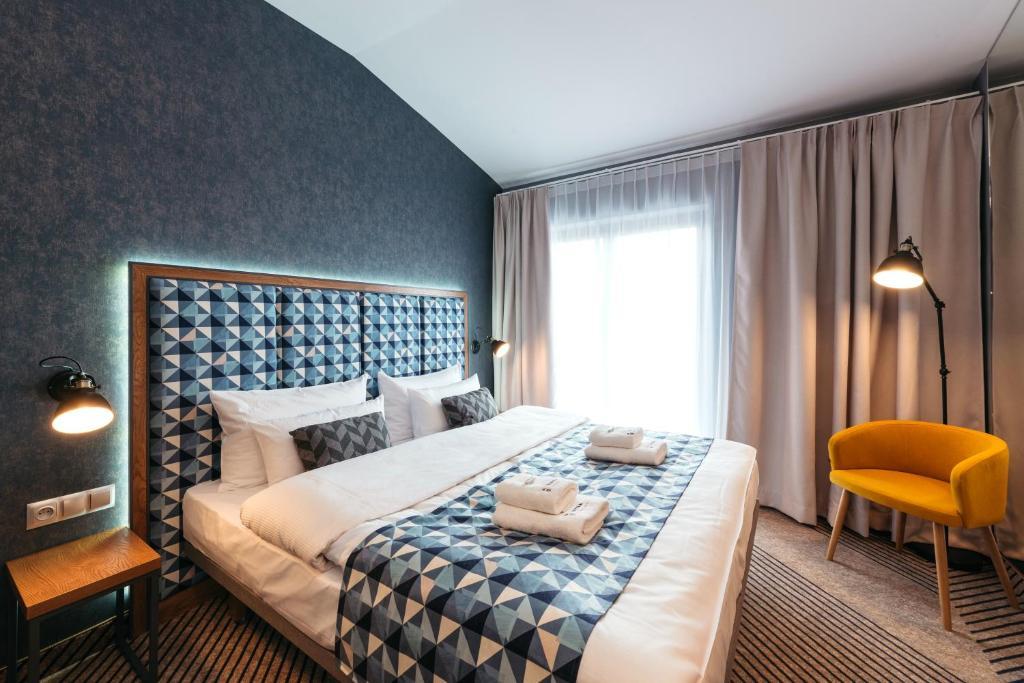 Łóżko lub łóżka w pokoju w obiekcie Avena by Artery Hotels