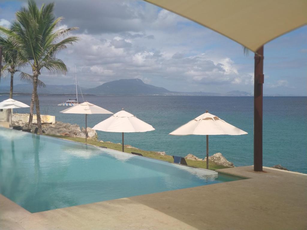 The swimming pool at or near Beach Front Infiniti Blu Condo