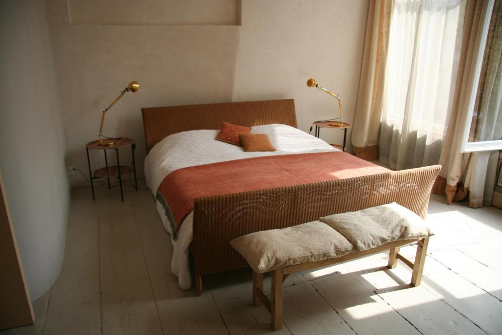 A bed or beds in a room at Casa Luna