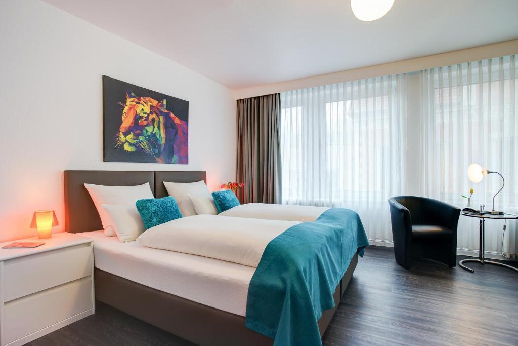Ein Bett oder Betten in einem Zimmer der Unterkunft Centro Hotel Atlanta