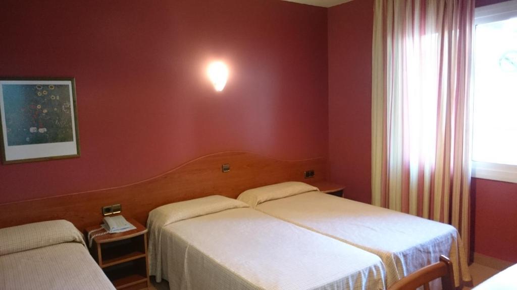 Кровать или кровати в номере Hotel Athene Neos