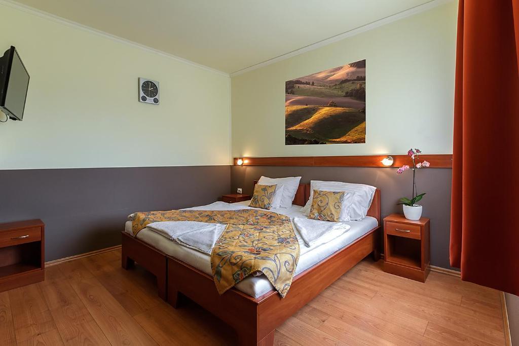 8c1fc9164b Ein Bett oder Betten in einem Zimmer der Unterkunft Aranypatkó  Fogadó-Étterem