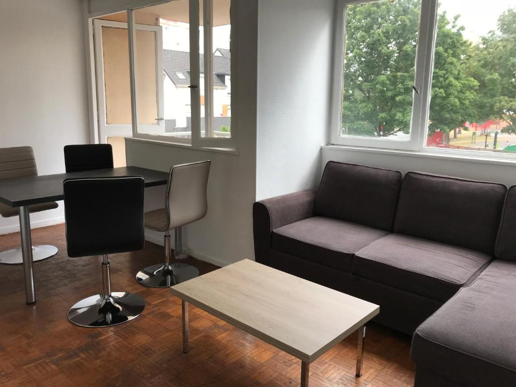 A seating area at Appartement du Zenith