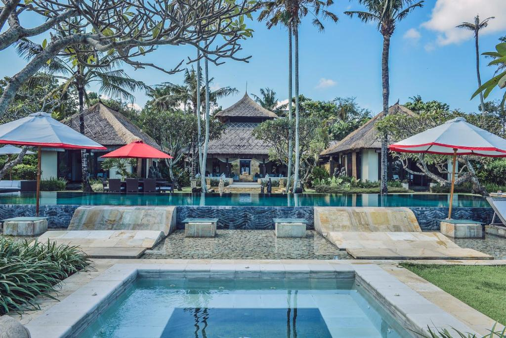 The swimming pool at or near Ombak Luwung Beachfront Estate