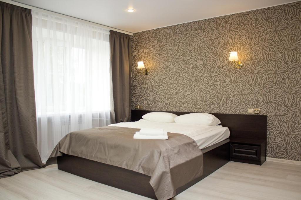Кровать или кровати в номере Kargopolochka Hotel