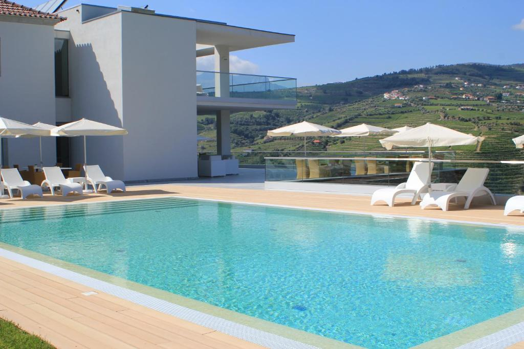 The swimming pool at or near Delfim Douro Hotel