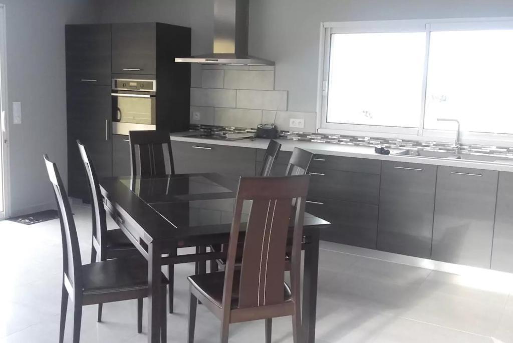 Cuisine ou kitchenette dans l'établissement Maison de charme