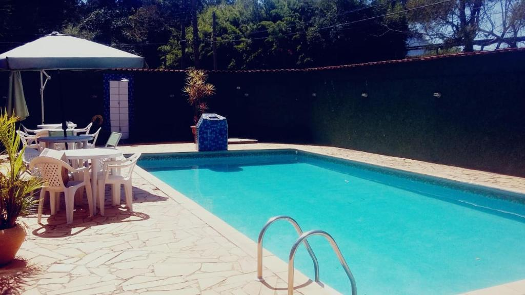 The swimming pool at or near Pousada Recanto das Garças