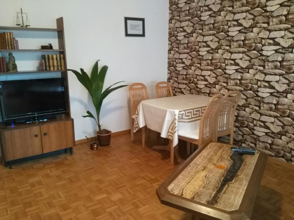 A seating area at Calm Family Apartment