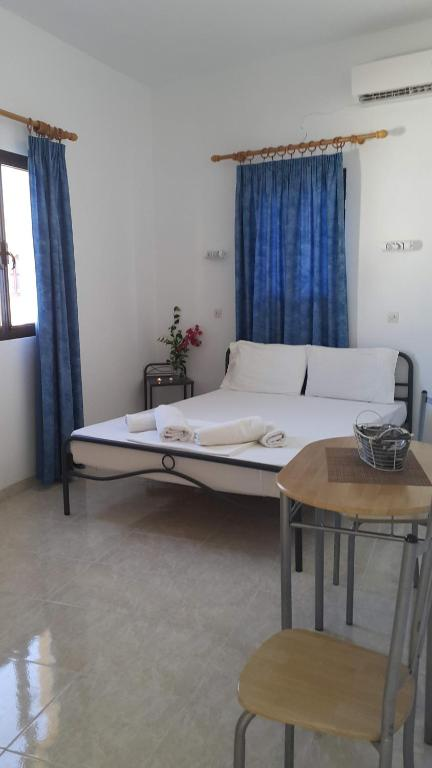 A bed or beds in a room at Lindos Center Studios