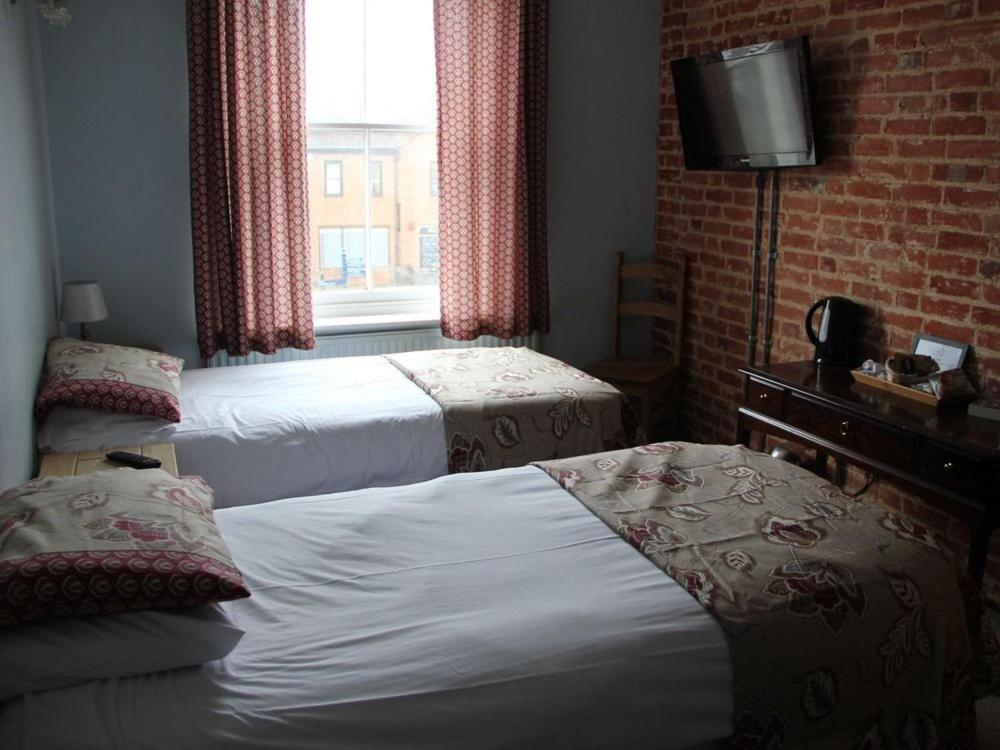 A bed or beds in a room at The Market Hotel