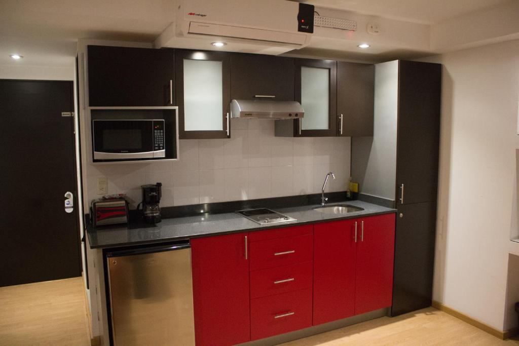 A kitchen or kitchenette at My Home Suites