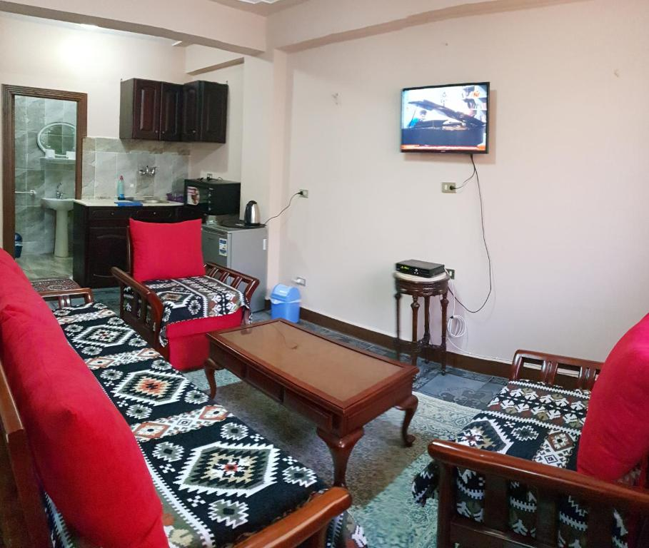 A television and/or entertainment center at Caesar Hostel