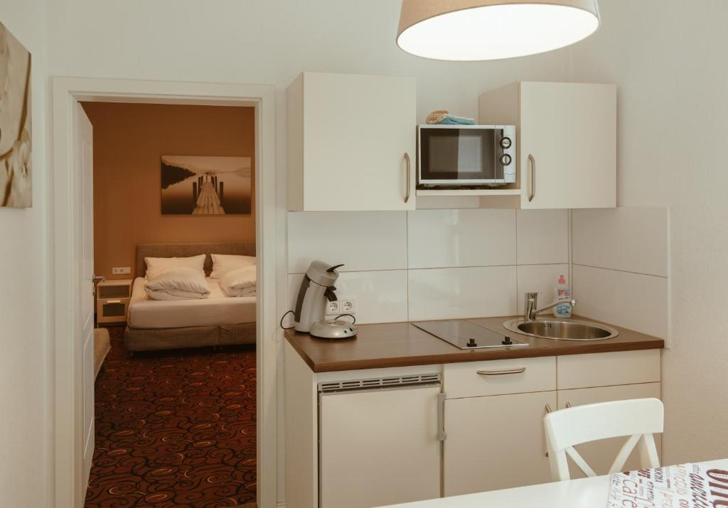 A kitchen or kitchenette at Hofgarten Apartments