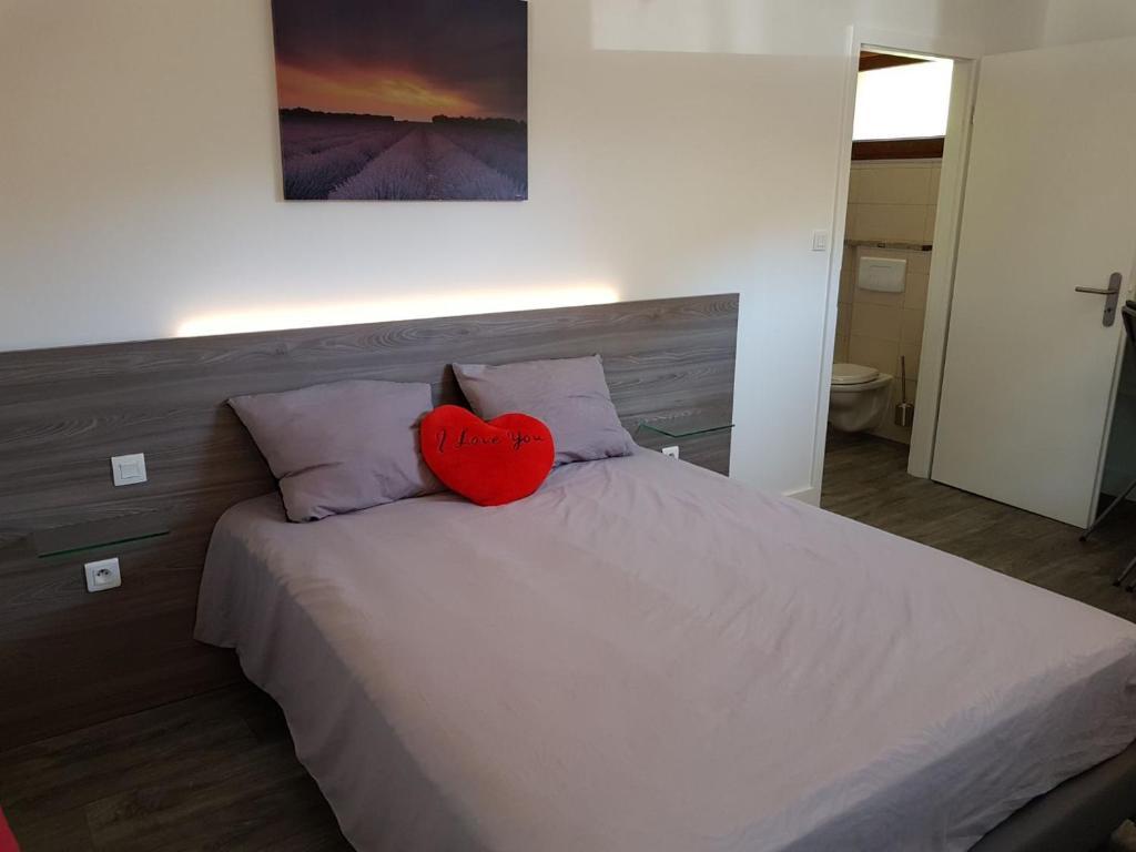 Un ou plusieurs lits dans un hébergement de l'établissement FRANCK