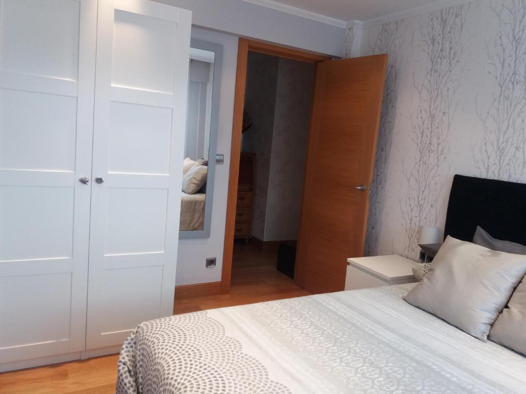 A bed or beds in a room at Habitación y baño privado