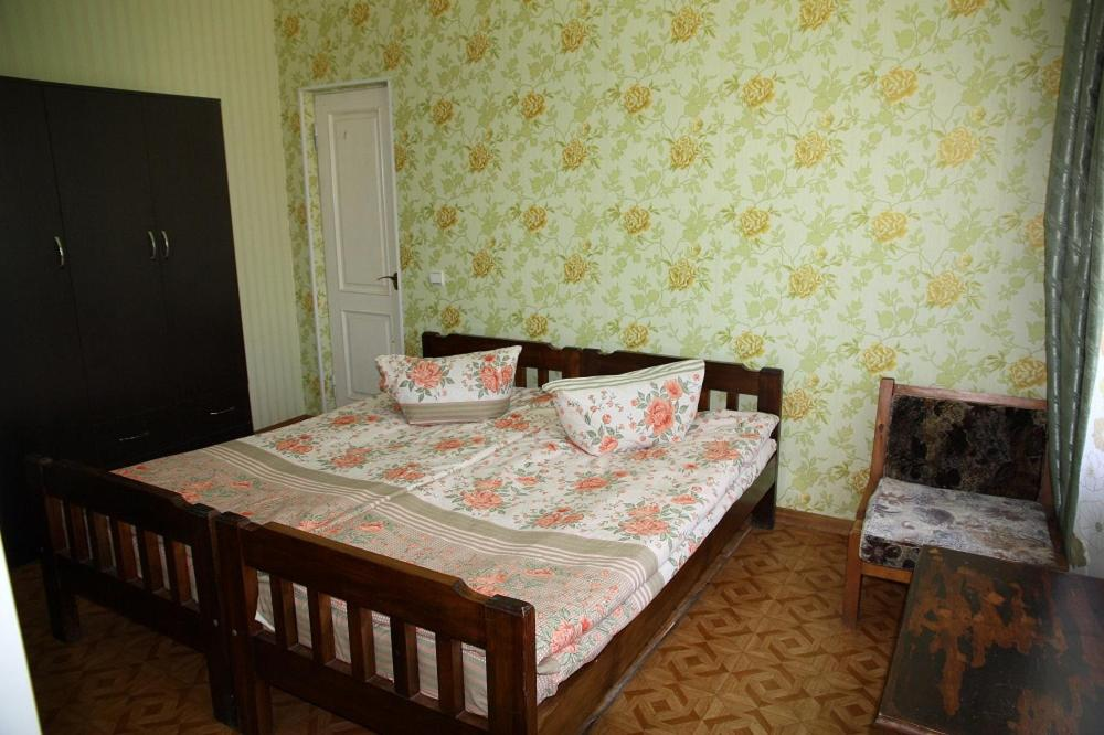 A bed or beds in a room at u Zheni i Ludy Guest House