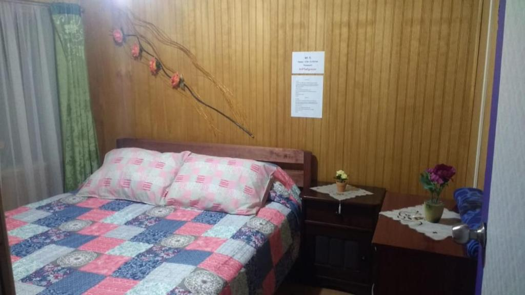 A bed or beds in a room at Mi Hostal Tu Casa