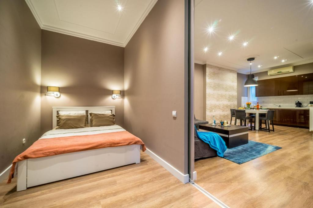 A bed or beds in a room at Luxury home in the heart of Budapest (Sas street)