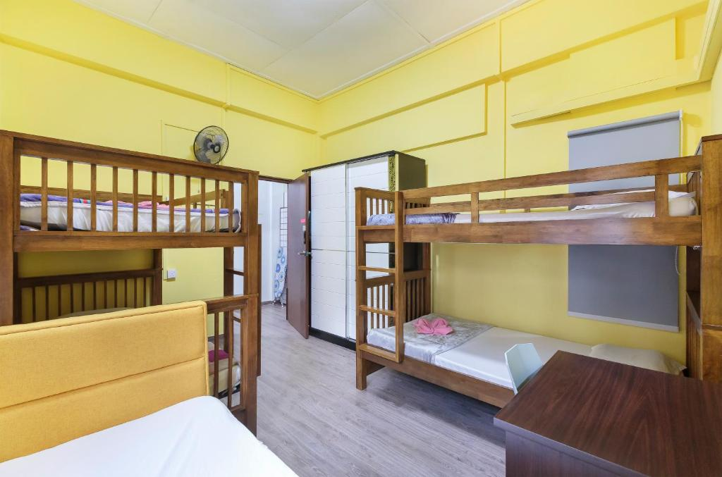 A bunk bed or bunk beds in a room at Conservation Shophouse