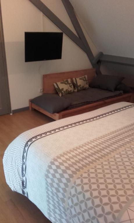Un ou plusieurs lits dans un hébergement de l'établissement L Auberge Du Snouk