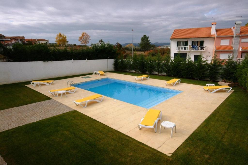 The swimming pool at or near Casa Dr. Bonfim