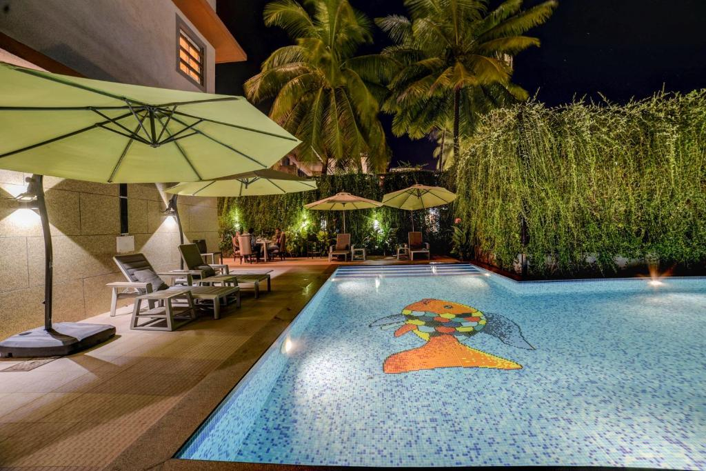 The swimming pool at or near FabHotel Prime Sarala Crown Calangute Beach