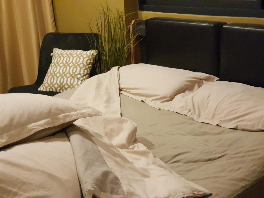 A bed or beds in a room at Stay tiny