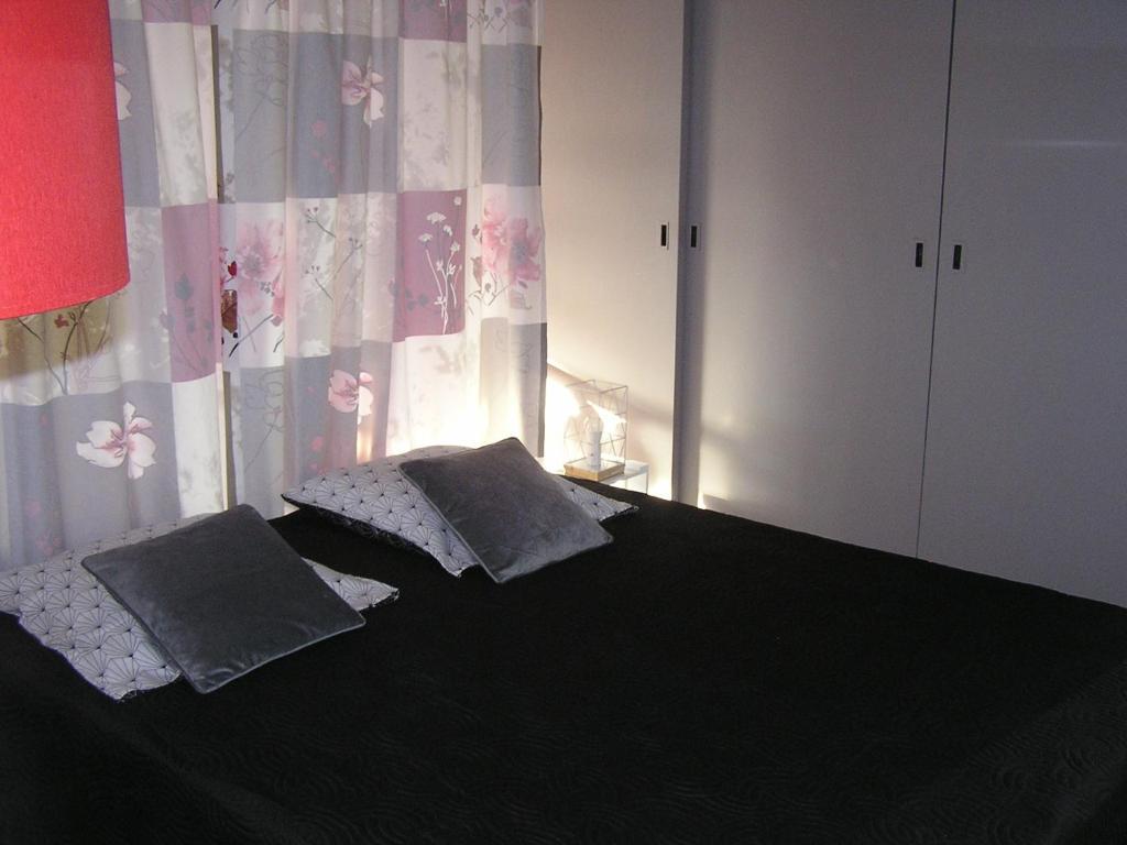 Un ou plusieurs lits dans un hébergement de l'établissement Studio du Devorah
