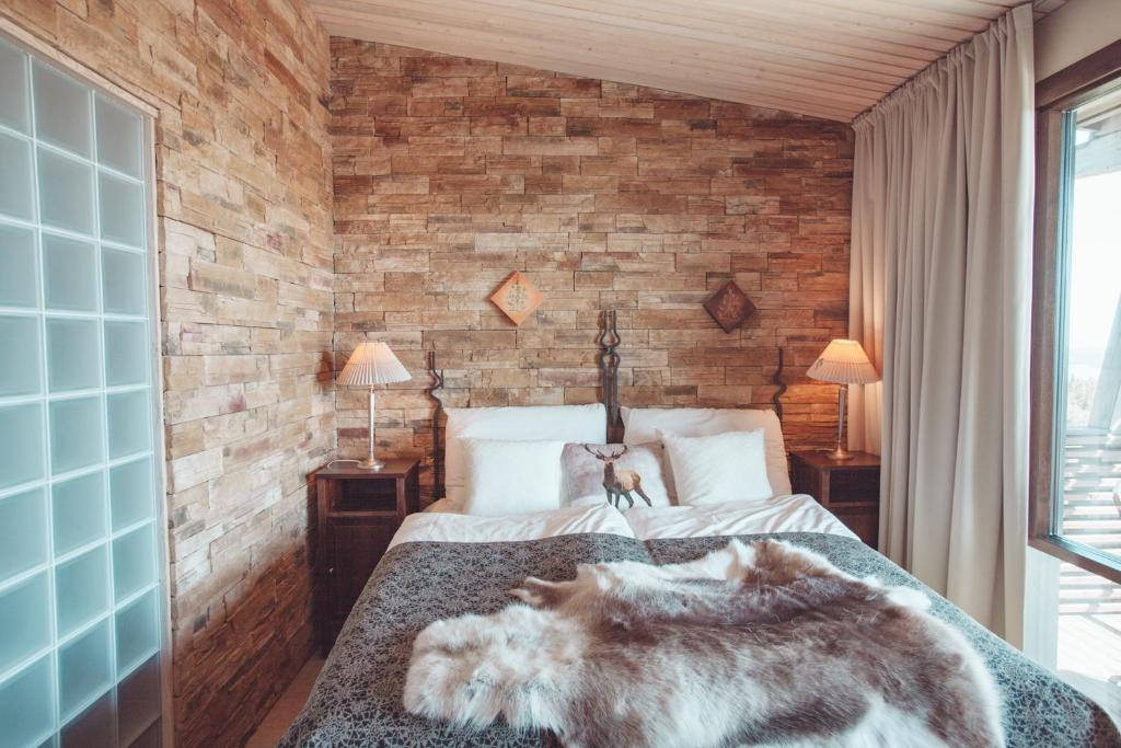 A bed or beds in a room at Ruka Peak - Boutique Hotel & Restaurant