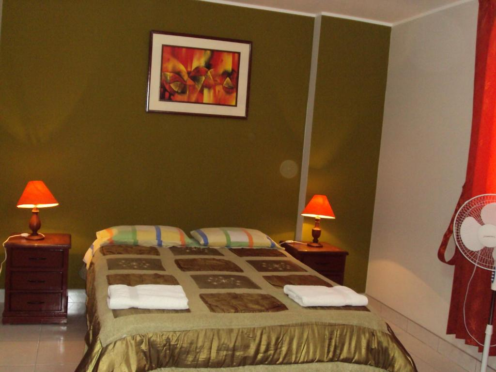 A bed or beds in a room at Nasca Lodge