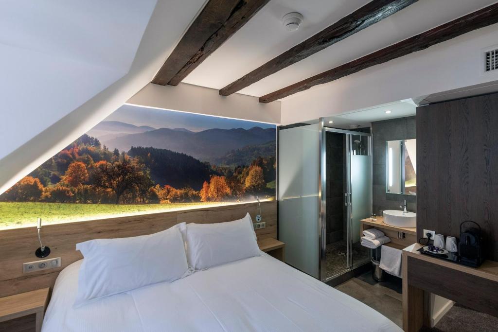 Кровать или кровати в номере Hotel KLE