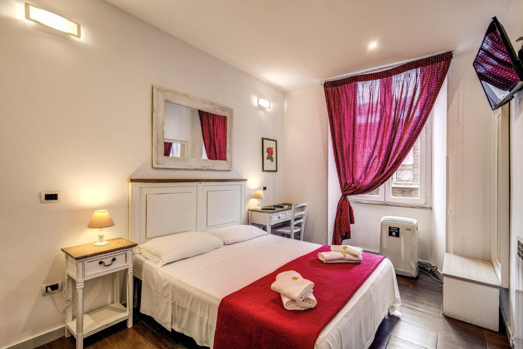 Uma cama ou camas num quarto em Exotic GuestHouse