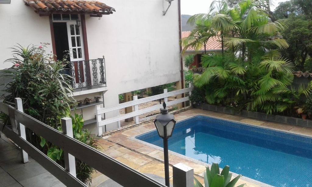 The swimming pool at or near Pousada Dona Denis