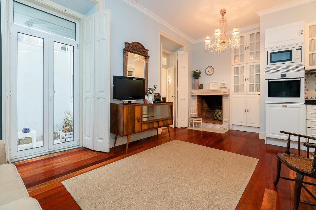 A television and/or entertainment center at Charming 3 bedroom apartment at Anjos