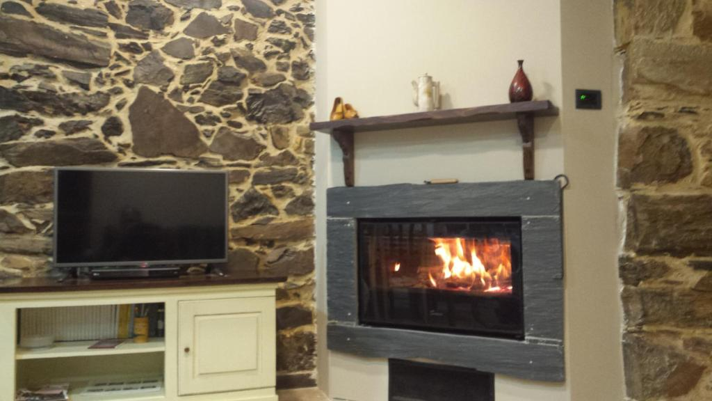 A television and/or entertainment center at Casa Canedo Suite