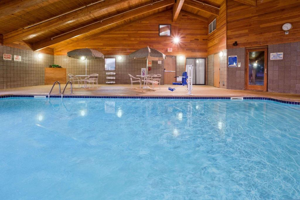 The swimming pool at or near AmericInn by Wyndham Coon Rapids