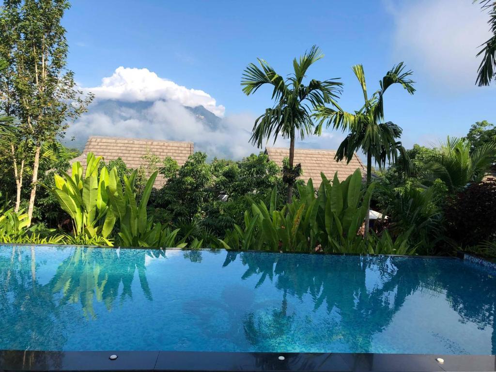 The swimming pool at or near Buraphat Resort