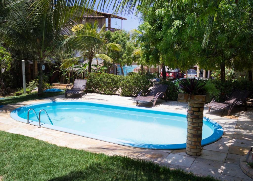The swimming pool at or near Pousada Morada do Sol