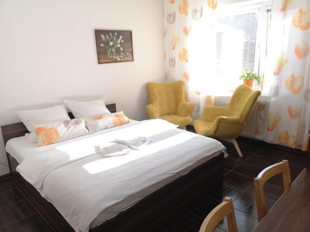 En eller flere senge i et værelse på Apartmány Dreams