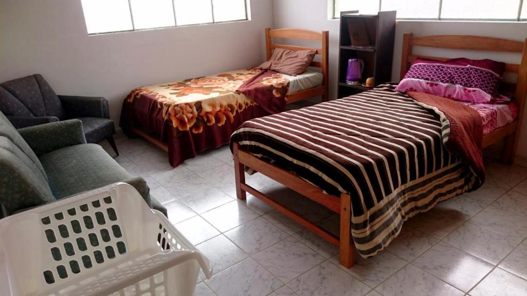 Cama o camas de una habitación en Con amigos en Casa