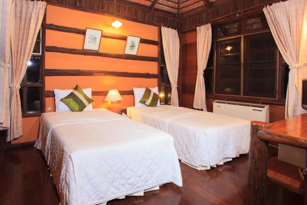 A bed or beds in a room at Pasak Hillside Resort