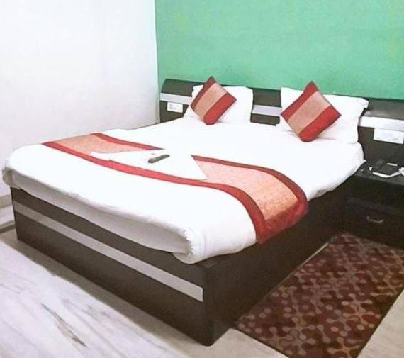 A bed or beds in a room at Airport Hotel Aerocity Inn
