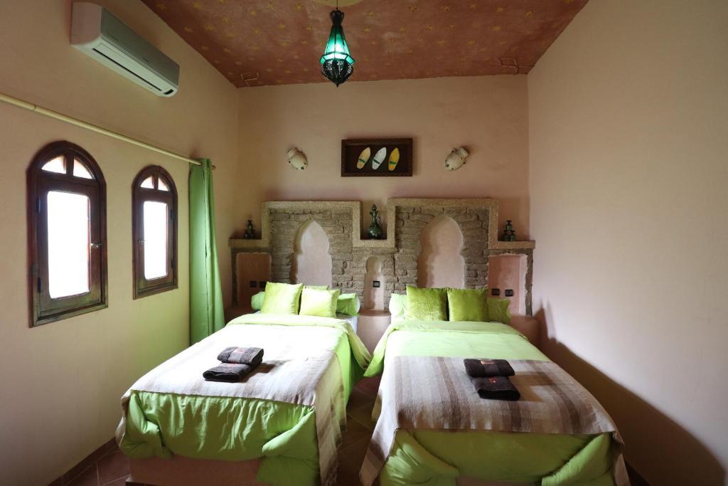 Cama o camas de una habitación en Riad Moha