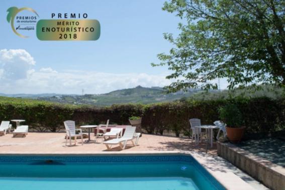 The swimming pool at or near Casa Rural Finca Buytrón